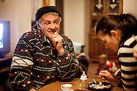 Elvis Causevic's father Nedzib and sister Elvira in the kitchen of the family home. <br /> <br /> In 1992 while volunteering at the Varazdin refugee camp Panos photographer Bjoern Steinz met and became close to Elvis, a Bosnian Muslim refugee, and his family. They shared the hardships of camp life together which Steinz documented. While the prints were archived for many years two of the images always returned to Bjoern's thoughts. 25 years later he set out to try and find out what had happened to Elvis and his family in the intervening years. Modern social media made the task surprisingly easy and they were reunited in Hadzici where Elvis now lives with his family.