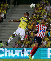 BUCARAMANGA-COLOMBIA, 07-03-2020: Homer Martinez de Atletico Bucaramanga y Willer Ditta de Atletico Junior disputan el balon, durante partido entre Atletico Bucaramanga y Atletico Junior, de la fecha 8 por la Liga BetPlay DIMAYOR I 2020, jugado en el estadio Alfonso Lopez de la ciudad de Bucaramanga. / Homer Martinez of Atletico Bucaramanga and Willer Ditta of Atletico Junior vie for the ball during a match between Atletico Bucaramanga and Atletico Junior, of the 8th date for the BetPlay DIMAYOR I Legauje 2020 at the Alfonso Lopez stadium in Bucaramanga city. / Photo: VizzorImage / Jaime Moreno / Cont.