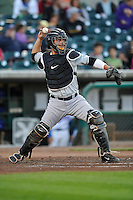 Jesus Flores #25 throws to second base against the Iowa Cubs at Principal Park on July 2, 2014 in Des Moines, Iowa. The Cubs  beat Storm Chasers 4-3.   (Dennis Hubbard/Four Seam Images)