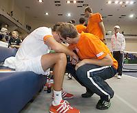 06-03-11, Tennis, Oekraine, Kharkov, Daviscup, Oekraine - Netherlands,  Robin Haase wint beslisende set, en wordt als eerste gefeliciteerd door zijn ploeggenoot Thiemo de Bakker