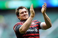 Alex Goode of Saracens thanks fans on a victory lap after winning the Heineken Cup semi-final match between Saracens and ASM Clermont Auvergne at Twickenham Stadium on Saturday 26th April 2014 (Photo by Rob Munro)