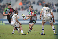 20130309 Copyright onEdition 2013©.Free for editorial use image, please credit: onEdition..George Lowe of Harlequins passes to Charlie Matthews of Harlequins despite the attentions of Kyle Eastmond (2nd left) and Matt Banahan of Bath Rugby during the LV= Cup semi final match between Harlequins and Bath Rugby at The Twickenham Stoop on Saturday 9th March 2013 (Photo by Rob Munro)..For press contacts contact: Sam Feasey at brandRapport on M: +44 (0)7717 757114 E: SFeasey@brand-rapport.com..If you require a higher resolution image or you have any other onEdition photographic enquiries, please contact onEdition on 0845 900 2 900 or email info@onEdition.com.This image is copyright onEdition 2013©..This image has been supplied by onEdition and must be credited onEdition. The author is asserting his full Moral rights in relation to the publication of this image. Rights for onward transmission of any image or file is not granted or implied. Changing or deleting Copyright information is illegal as specified in the Copyright, Design and Patents Act 1988. If you are in any way unsure of your right to publish this image please contact onEdition on 0845 900 2 900 or email info@onEdition.com