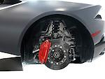 Closeup of Lamborghini sports car performance ceramic brakes, a disc and a caliper Image © MaximImages, License at https://www.maximimages.com