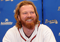 Pitcher Tommy Hanson of the Atlanta Braves signs autographs for fans on January 27, 2012 at Academy Sports and Outdoors in Spartanburg, South Carolina. It was the first day of the 2012 Braves Country Caravan, which visits cities all across the South prior to Spring Training. (Tom Priddy/Four Seam Images)