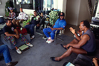 LOS ANGELES, CA - Former Cleveland Browns great Jim Brown works with former gang members in his home in Los Angeles, California in 1991. Photo by Brad Mangin