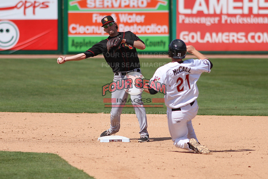 Quad Cities River Bandits shortstop Thomas Lindauer (1) turns a double play as Gregory McCall (21) slides in during a game against the Wisconsin Timber Rattlers on May 2nd, 2015 at Fox Cities Stadium in Appleton, Wisconsin.  Quad Cities defeated Wisconsin 5-2.  (Brad Krause/Four Seam Images)