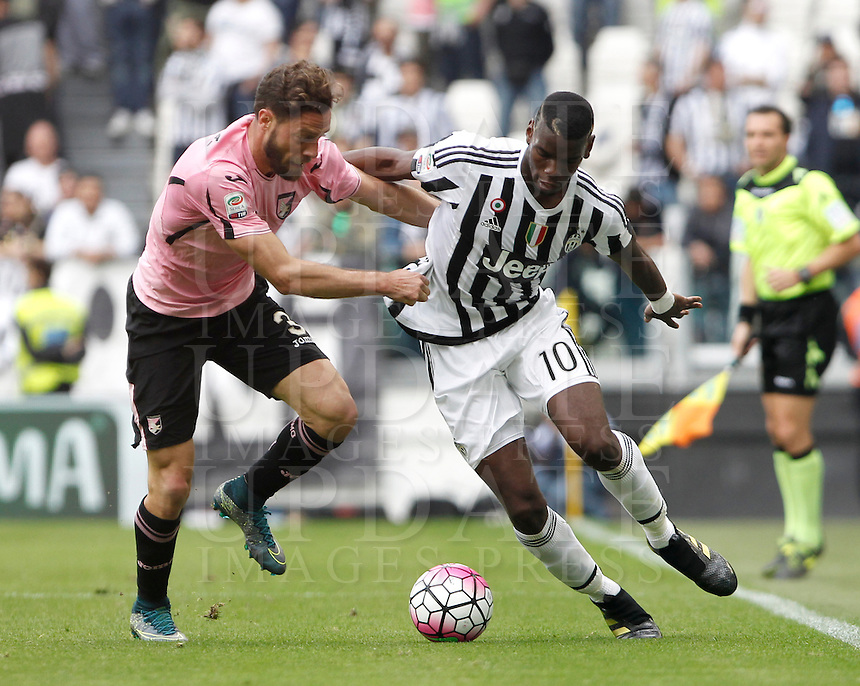 Calcio, Serie A: Juventus vs Palermo. Torino, Juventus Stadium, 17 aprile 2016.<br /> Juventus' Paul Pogba, right, is challenged by Palermo's Andrea Rispoli during the Italian Serie A football match between Juventus and Palermo at Turin's Juventus Stadium, 17 April 2016.<br /> UPDATE IMAGES PRESS/Isabella Bonotto