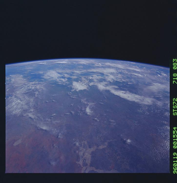 John Angerson. STS-72 Book.<br /> Public Domain Image.<br /> NASA images Courtesy National Archives - Record Group number: 255-STS-STS072<br /> <br /> <br /> Description: Earth observations taken from shuttle orbiter Endeavour during STS-72 mission.<br /> <br /> Subject Terms: STS-72, ENDEAVOUR (ORBITER), EARTH OBSERVATIONS (FROM SPACE), EARTH LIMB<br /> <br /> Date Taken: 1/19/1996<br /> <br /> Categories: Earth Observations<br /> <br /> Interior_Exterior: Exterior<br /> <br /> Ground_Orbit: On-orbit<br /> <br /> Original: Film - 70MM CT<br /> <br /> Preservation File Format: TIFF<br /> <br /> geon: AUSTRALIA-NT<br /> <br /> feat: PAN-DRAINAGE, SALT PANS<br /> <br /> tilt: High Oblique<br /> <br /> cldp: 30<br /> <br /> nlat: -18.5<br /> <br /> nlon: 134.1<br /> <br /> azi: 101<br /> <br /> alt: 167<br /> <br /> elev: 48