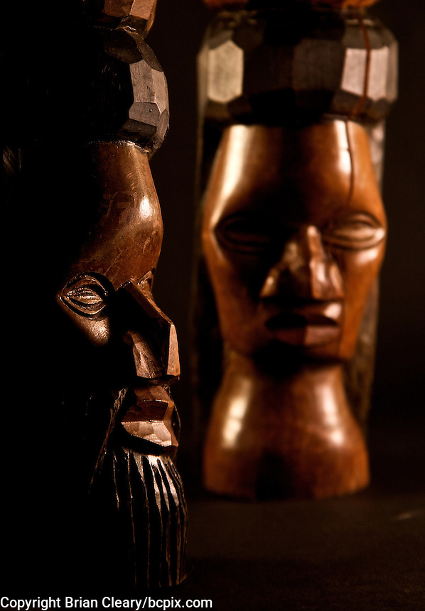 A hand-carved pair of wooden busts of an African man and woman  bookends photographed in the studio.  (Photo by Brian Cleary/www.bcpix.com)