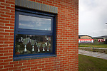 Redcar Athletic 1 Holker Old Boys 2, 31/10/2020. BM Bi-Folding Doors Football Park, Redcar, FA Vase First Round. Trophies on display in a window of the club house before Redcar Athletic host Holker Old Boys in an FA Vase First Round tie at the BM Bi-Folding Doors Football Park, Redcar. The club was established in 1993 as Teesside Athletic but changed to Redcar Athletic in 2010 and were promoted into the Northern League Division Two in 2018. The visitors from the North West Counties League won this match by 2-1, watched by a crowd of 197 spectators. Photo by Colin McPherson.