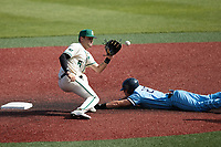 Charlotte 49ers shortstop Jack Dragum (6) waits for a throw as Thomas Wheeler (27) of the Old Dominion Monarchs slides head first into second base at Hayes Stadium on April 25, 2021 in Charlotte, North Carolina. (Brian Westerholt/Four Seam Images)