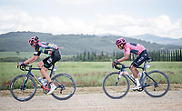"""GC contenders Hugh Carthy (GBR/EF Education - Nippo) & Maglia Rosa / Pink Jersey Egan Bernal (COL/Ineos Grenadiers) over the final gravel sector of the day.<br /> <br /> 104th Giro d'Italia 2021 (2.UWT)<br /> Stage 11 from Perugia to Montalcino (162km)<br /> """"the Strade Bianche stage""""<br /> <br /> ©kramon"""