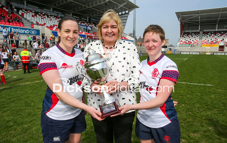 Saturday 20th April 2019 | 2019 Ulster Women's Junior Cup Final<br /> <br /> Malone Women's captains Eimear Hagan and Jenna Stewart receive the Ulster Women's Junior Cup from Ulster Branch representative Pamela Stevenson after Malone defeated City Of Derry 29-17 in the final at Kingspan Stadium on Easter Saturday. Photo John Dickson/Dicksondigital