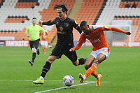 Blackpool's CJ Hamilton crosses despite the attentions of Milton Keynes Dons' George Williams<br /> <br /> Photographer Kevin Barnes/CameraSport<br /> <br /> The EFL Sky Bet League One - Blackpool v Milton Keynes Dons - Saturday 24 October 2020 - Bloomfield Road - Blackpool<br /> <br /> World Copyright © 2020 CameraSport. All rights reserved. 43 Linden Ave. Countesthorpe. Leicester. England. LE8 5PG - Tel: +44 (0) 116 277 4147 - admin@camerasport.com - www.camerasport.com