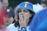 An Italian fan looks on with concern after France scored an early goal in the 2006 FIFA World Cup Final match. The fan was watching the match on large outdoor public screens at the FIFA World Cup Fan Fest in Tiergarten park in Berlin. The game was held at the Olympic Stadium in Berlin, Germany on Sunday July 9th, 2006. Italy won on penalty-kicks, 5-3, over France after the match ended up in a draw in regulation and extra time