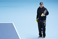 Coach Boris Becker watches Novak Djokovic train during a media day at the Barclays ATP World Tour Finals at The O2 centre, North Greenwich, London.