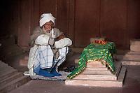 Fatehpur Sikri, Uttar Pradesh, India.  Old Man Sitting by a Grave in the Jama Masjid (Dargah Mosque).