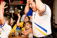 Ecuador fans watch their team play England in a World Cup match on June 25, 2006 at Chibcha, a restaurant and nightclub in New York City.<br /> <br /> The World Cup, held every four years in different locales, is the world's pre-eminent sports tournament in the world's most popular sport, soccer (or football, as most of the world calls it).  Qualification for the World Cup is open to any country with a national team accredited by FIFA, world soccer's governing body. The first World Cup, organized by FIFA in response to the popularity of the first Olympic Games' soccer tournaments, was held in 1930 in Uruguay and was participated in by 13 nations.    <br /> <br /> As of 2010 there are 208 such teams.  The final field of the World Cup is narrowed down to 32 national teams in the three years preceding the tournament, with each region of the world allotted a specific number of spots.  <br /> <br /> The World Cup is the most widely regularly watched event in the world, with soccer teams being a source of national pride.  In most nations, the whole country is at a standstill when their team is playing in the tournament, everyone's eyes glued to their televisions or their ears to the radio, to see if their team will prevail.  While the United States in general is a conspicuous exception to the grip of World Cup fever there is one city that is a rather large exception to that rule.  In New York City, the most diverse city in a nation of immigrants, the melting pot that is America is on full display as fans of all nations gather in all possible venues to watch their teams and celebrate where they have come from.