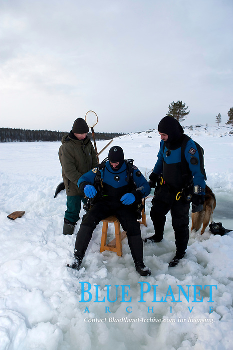 Scuba diver ready to go diving under the ice, Arctic circle Dive Center, White Sea, Karelia, northern Russia