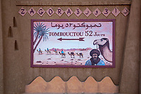 """Zagora, Morocco.  """"Timbuktu 52 Days"""" Sign Alluding to the Time Needed to Reach Timbuktu by Camel Caravan."""