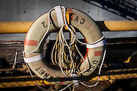 A life preserver ring with ropes at the USS Hornet in Alameda, California.