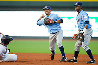 Shortstop Christian Colon #12 of the Wilmington Blue Rocks turns a double play against the Winston-Salem Dash at  BB&T Ballpark August 4, 2010, in Winston-Salem, North Carolina.  Photo by Brian Westerholt / Four Seam Images