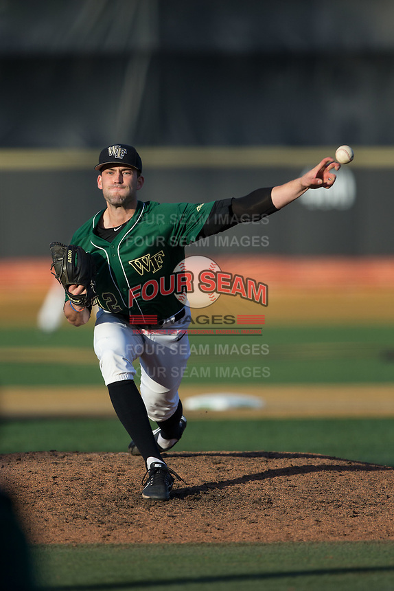 Wake Forest Demon Deacons relief pitcher Tyler Witt (12) delivers a pitch to the plate against the Louisville Cardinals at David F. Couch Ballpark on March 17, 2018 in  Winston-Salem, North Carolina.  The Cardinals defeated the Demon Deacons 11-6.  (Brian Westerholt/Four Seam Images)