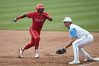 Devonte Brown (3) of the North Carolina State Wolfpack hustles back towards first base as Tyler Causey (6) of the North Carolina Tar Heels waits for a throw at Boshamer Stadium on March 27, 2021 in Chapel Hill, North Carolina. (Brian Westerholt/Four Seam Images)