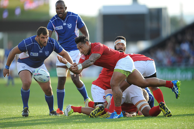 Sonatane Takulua of Tonga passes during Match 20 of the Rugby World Cup 2015 between Tonga and Namibia - 29/09/2015 - Sandy Park, Exeter<br /> Mandatory Credit: Rob Munro/Stewart Communications