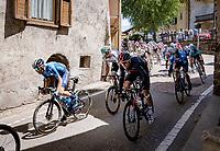 peloton rolling through town<br /> <br /> 104th Giro d'Italia 2021 (2.UWT)<br /> Stage 17 from Canazei to Sega di Ala (193km)<br /> <br /> ©kramon