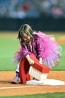 Nashville Sounds young fan dressed as the tooth fairy cleans third base in between innings during a game against the Omaha Storm Chasers on May 19, 2014 at Herschel Greer Stadium in Nashville, Tennessee.  Nashville defeated Omaha 5-4.  (Mike Janes/Four Seam Images)