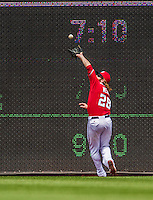26 April 2014: Washington Nationals right fielder Jayson Werth pulls in a Rene Rivera fly ball in the 3rd inning against the San Diego Padres at Nationals Park in Washington, DC. The Nationals defeated the Padres 4-0 to take the third game of their 4-game series. Mandatory Credit: Ed Wolfstein Photo *** RAW (NEF) Image File Available ***
