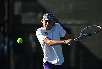 Fayetteville's Jacob Nordin hits, Monday, October 11, 2021 during the 6A state girls and boys tennis tournament at Memorial Park in Bentonville. Check out nwaonline.com/211012Daily/ for today's photo gallery. <br /> (NWA Democrat-Gazette/Charlie Kaijo)