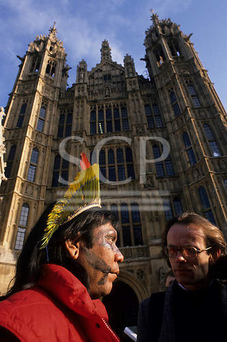 London, England. Payakan Kayapo with Charles Secrett, Director of Friends of the Earth, at the Houses of Parliament, May 1989.