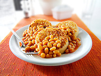 Baked beans on crumpets stock photos
