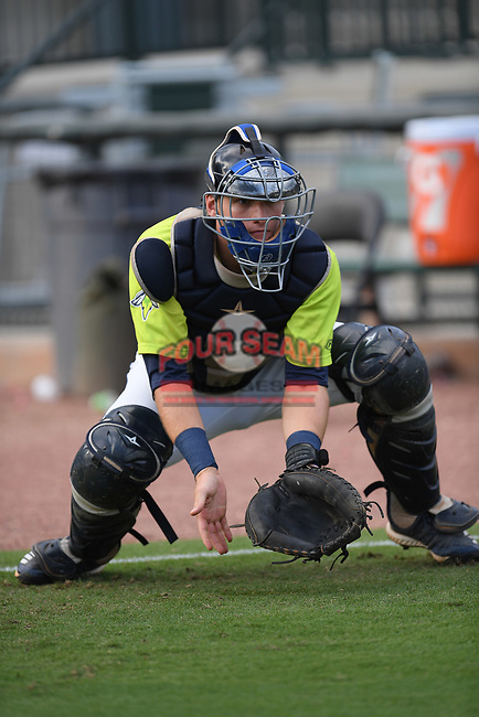 Catcher Hayden Senger (15) of the Columbia Fireflies warms up before a game against the Hickory Crawdads on Tuesday, August 27, 2019, at Segra Park in Columbia, South Carolina. Columbia won, 3-2. (Tom Priddy/Four Seam Images)