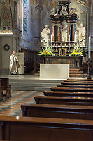 "Switzerland. Canton Ticino. Lugano. Easter in Cattedrale di San Lorenzo. The bishop Valerio Lazzeri celebrates the Sunday mass in an empty cathedral. The believers could not attend the religious service due to the coronavirus. Valerio Lazzeri (born 22 July 1963) is a Swiss Roman Catholic bishop. Ordained to the priesthood on 2 September 1989, Lazzeri was named bishop of the Roman Catholic Diocese of Lugano, Switzerland on 4 November 2013. Easter, also called Pascha or Resurrection Sunday, is a festival and holiday commemorating the resurrection of Jesus from the dead, described in the New Testament as having occurred on the third day after his burial following his crucifixion by the Romans. The Diocese of Lugano is a branch of the Catholic Church immediately subject to the Holy See.  Due to the spread of the coronavirus (also called Covid-19), the Federal Council has categorised the situation in the country as ""extraordinary"". It has issued a recommendation to all citizens to stay at home, especially the sick and the elderly. From March 16 the government ramped up its response to the widening pandemic, ordering the closure of religious services. 12.04.2020  © 2020 Didier Ruef"