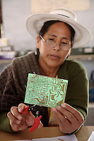 A Bolivian woman, in Rajasthan as part of the Barefoot College's international teaching scheme, learns how to maintain solar panels. International students take the skills they have learned back to villages in their own countries to set up rural solar energy projects...