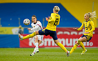 SOLNA, SWEDEN - APRIL 10: Kelley O'Hara #5 of the United States sends a crossing ball into the box during a game between Sweden and USWNT at Friends Arena on April 10, 2021 in Solna, Sweden.