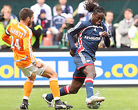 Shalrie Joseph (21) of New England turns the ball away from Houston captain Wade Barrett (24). The Houston Dynamo defeated the New England Revolution 2-1 in the finals of the MLS Cup at RFK Memorial Stadium in Washington, D. C., on November 18, 2007.
