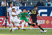 CARSON, CA - MAY 8: Jonathan dos Santos #8 of the Los Angeles Galaxy attempts to block a shot by Eduard Atuesta #20 of LAFC during a game between Los Angeles FC and Los Angeles Galaxy at Dignity Health Sports Park on May 8, 2021 in Carson, California.