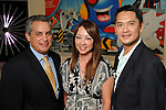 From left: Nick Rivera, Yuki Rogers and Dominic Nguyen at  a reception at the home of Jereann Cheney announcing the Houston exhibition of Ai Weiwei's Circle of Animals / Zodiac HeadsWednesday May 25,2011.(Dave Rossman/For the Chronicle)