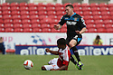 Sam Wedgbury of Stevenage is tackled by Nathan Byrne of Swindon<br />  Swindon Town v Stevenage - Sky Bet League One- The County Ground, Swindon - 10th August 2013<br /> © Kevin Coleman 2013