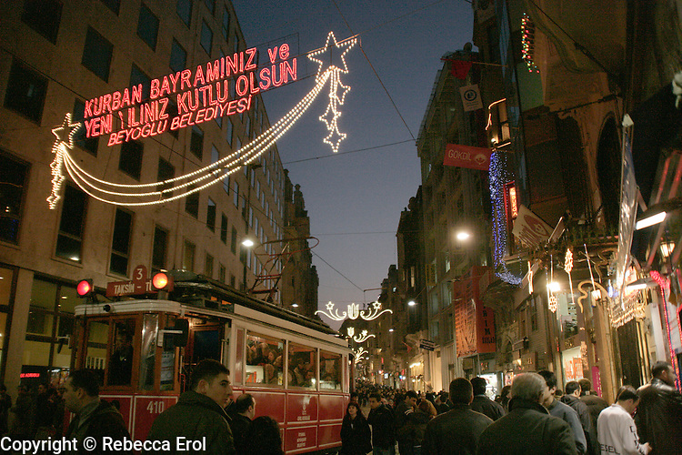 ISTIKLAL STREET WITH NEW YEAR LIGHTS, ISTANBUL, TURKEY The sign in lights says: Happy New Year and Eid from the Beyoglu local council