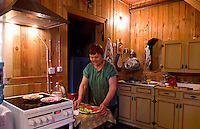 Women at home preparing food in wooden kitchen, Listvyanka near  Irkutsk, Siberia, Russia