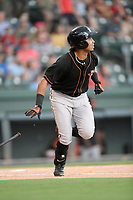 Left fielder Edison Lantigua (25) of the Delmarva Shorebirds runs out a batted ball in a game against the Greenville Drive on Friday, August 2, 2019, at Fluor Field at the West End in Greenville, South Carolina. The game was suspended in the second inning and will not be made up. (Tom Priddy/Four Seam Images)