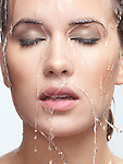 Closeup beauty portrait of a woman face with water pouring over it Image © MaximImages, License at https://www.maximimages.com