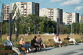 A park in front of residential housing blocks on the outskirts of Budapest.