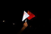 CHINA. Beijing. A Chinese flag and an Olympic flag being held during the opening ceremony of the Beijing Summer Olympics. 2008