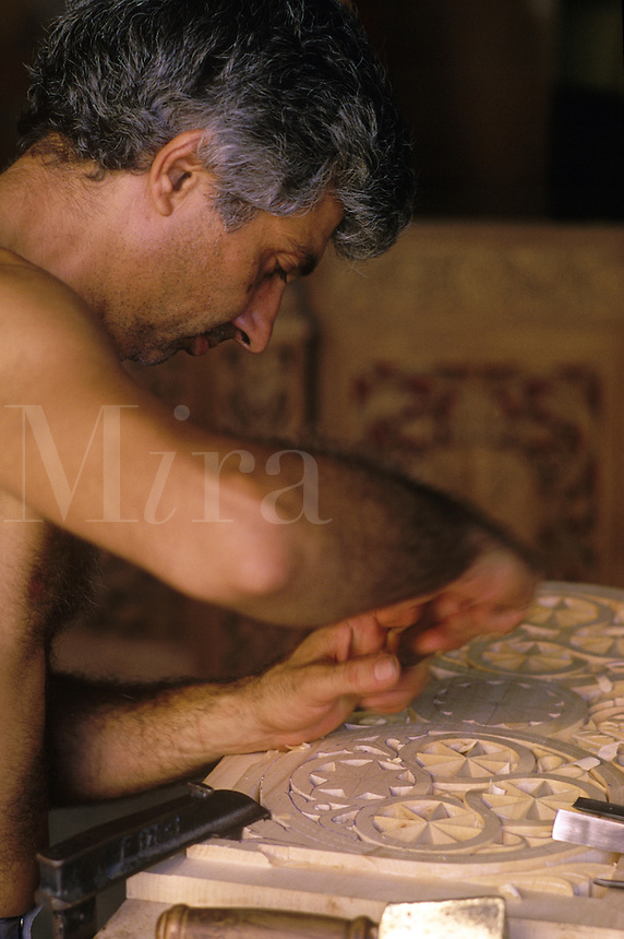 Woodcarver at work in his shop in Hania.